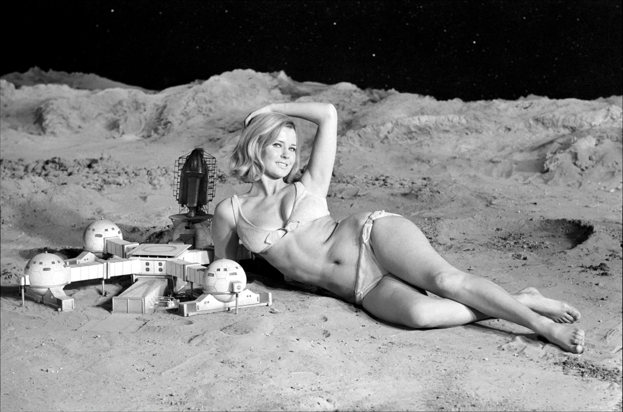 June Cooper, posing on UFO set